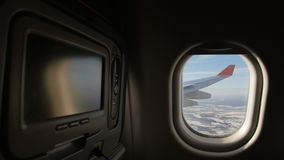Land seen through the window of jet airplane. Entertainment media system in front. Land seen through the window of jet airplane. Airplane slowly landing at stock video