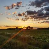 Land-Sonnenuntergang lizenzfreie stockbilder