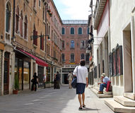 Land street in Venice royalty free stock images