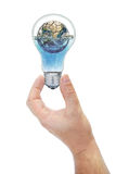 Land submerged in the bulb keeps hand Royalty Free Stock Photo