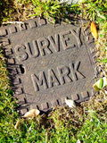 Land Survey Mark. Close-up of a covered survey mark used by land surveyors royalty free stock photos
