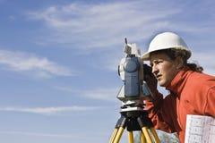 Land Surveying. Under cloudy sky Stock Image
