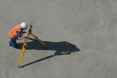 Land surveying. Aerial view of unrecognizable land surveying in construction site. copy space Royalty Free Stock Photos