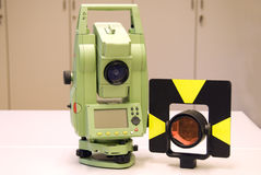 Land surveying and prism. Total station, land surveying and prism. Altometer - geodetic instrument royalty free stock images