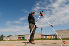 Land surveyor on construction site Royalty Free Stock Image