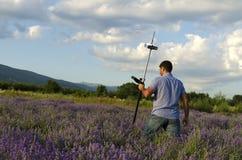 Land surveyor crossing lavender field Stock Photo