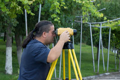 Land surveyor. Measuring with digital level device royalty free stock photography