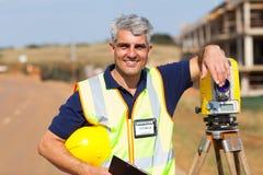 Land surveyor outdoors. Middle aged land surveyor portrait outdoors royalty free stock images