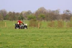Land surveyor with quad royalty free stock photo