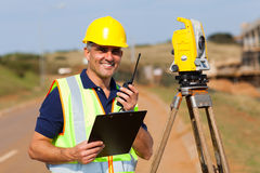 Land surveyor. Senior land surveyor working at road construction site Stock Photography