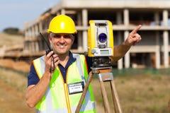 Land surveyor. Speaking on walkie talkie stock photography