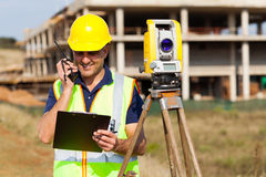 Land surveyor talking Stock Photo