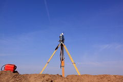 Land surveyor total station. Total station for measurements with blue sky. Surveyors provide data relevant to the shape, contour, location, elevation, or Stock Images