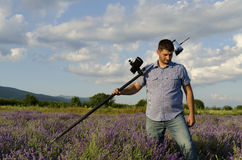 Land surveyor walking in a lavender field Stock Photos