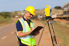 Land surveyor working. Senior surveyor working on the road royalty free stock photography
