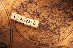Land text on a world map Stock Photo