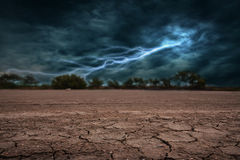 Land to the ground dry and cracked. With lightning storm Royalty Free Stock Photos