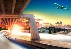 Land transport run into shipping port and container dock with fr. Eight cargo plane flying above stock photos
