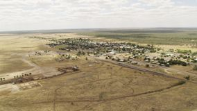 A land with trees and buildings from a far. A wide shot of land and trees and horizon in slow motion. Camera slowly moves to the right stock footage