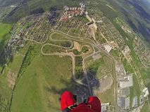 Land under my feet. Skydiver looks down and spotting green land under his feet Stock Image