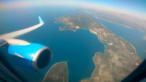 Land and water are seen from the airplane. HD stock video