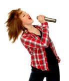 Land-westliches Mädchen, das in Mikrofon singt Lizenzfreie Stockfotografie