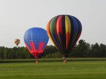 Landa för varmluftsballonger Fotografering för Bildbyråer