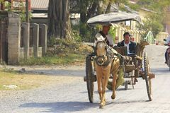 Horse carriages in Myanmar are still in use. stock photos