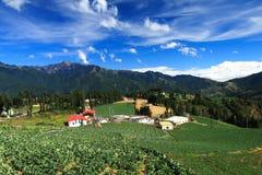 Landbouwbedrijf in de bergen Stock Afbeeldingen