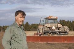 Landbouwer die een onderbreking nemen Stock Foto