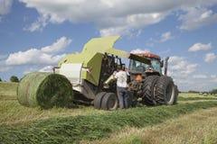 Landbouwer het veranderende opleveren Stock Foto