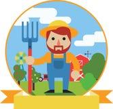 Landbouwer met hooivork op de achtergrond van de landbouwbedrijftuin Stock Afbeelding