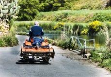 Landbouwer op zijn Tractor Royalty-vrije Stock Fotografie