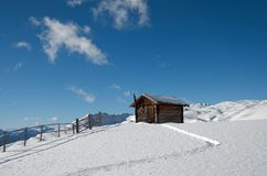 Landcape with cabin and footpath. Small wooden cabin in Austrian Alps Royalty Free Stock Photo