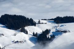 Landcape with houses. Houses above the clouds in Austrian Alps Stock Photo