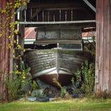 Landed Boat. A large boat docked in a decrepit barn Stock Images