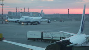 Landed plane goes to the parking at the international airport Vnukovo. stock video footage