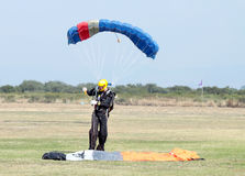 Landed skydiver looks as though he has extra small chute other. RUSTENBURG, SOUTH AFRICA - April 28, 2017: National Skydiving Championships.  Landed skydiver Royalty Free Stock Images
