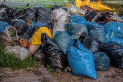 Landfill. A landfill with colorful rubbish sacs Stock Image