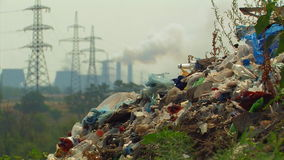 Landfill. On The Background Of Power Lines And Smoking Chimneys Of The Plant stock video