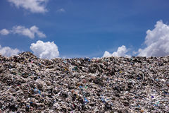 Landfill with blue sky and cumulus clouds Royalty Free Stock Photography