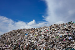 Landfill with blue sky and cumulus clouds Stock Image