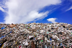 Landfill with blue sky and cumulus clouds Royalty Free Stock Image