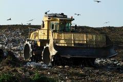 Landfill bulldozer. At dump site Royalty Free Stock Photography