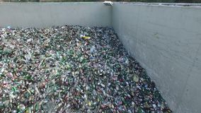 Landfill, composition of bottles, aerial view. Rubbish selection, top of used bottles stock video