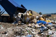 Landfill dump. Truck dumping trash in landfill Royalty Free Stock Image
