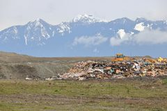 Garbage Dump and Vancouver`s Mountains royalty free stock photos