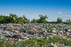 Landfill. Illegal landfill on green plants Stock Photos