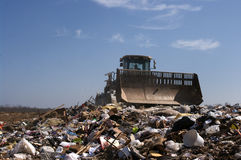 Landfill moving trash Stock Photos