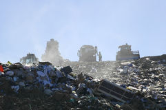 Landfill Operations. Workers at Landfill Performing Operations Royalty Free Stock Images